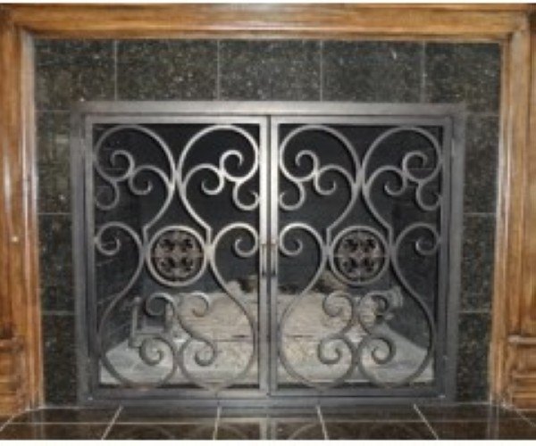 We custom design and install iron fireplace screens & fireplace doors. Our decorative fireplace screens can be modern